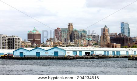 New York USA - September 2016: Brooklyn Port Authority Marine Terminal along the East River with Brooklyn Heights in the background.