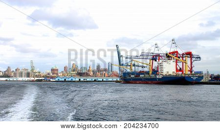 New York USA - 28 September 2016: Container Ship Conti Arabella docked at the Red Hook Marine Terminal along the Brooklyn waterfront.