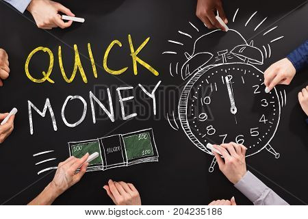 Hand Drawing Quick Money Concept On Blackboard
