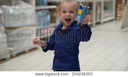 child buys baby food in a store or supermarket