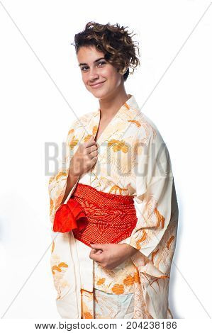 Teen age girl dressed in casual Japanese Yukata kimono standing with hands close.