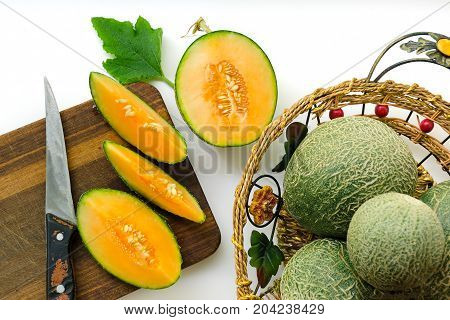 Composition With Fresh Ripe Melons On A White Background And Wooden Board. Selective Focus.