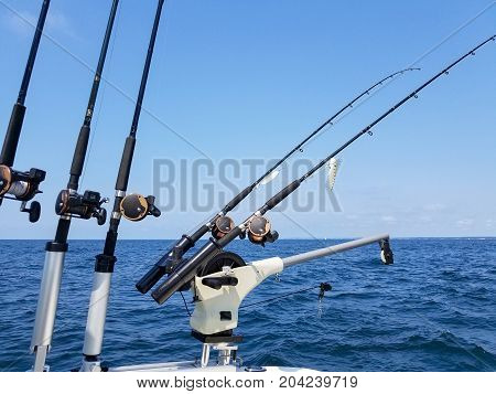 fishing rod and reels with lure on boat on Lake Michigan