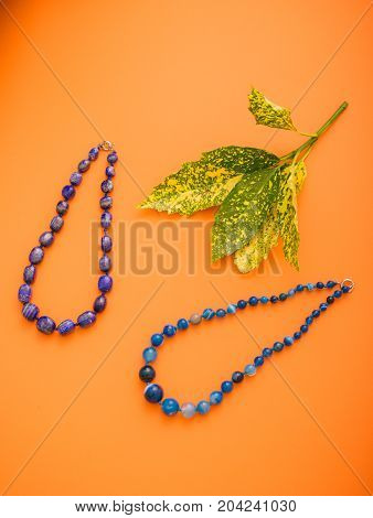 Colors Colorful Paper Background, Macro Photography, Close Up, Product Photography, Two Blue Necklac