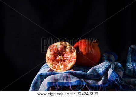 Closeup Ripe Pomegranate Fruit On Table  Background.