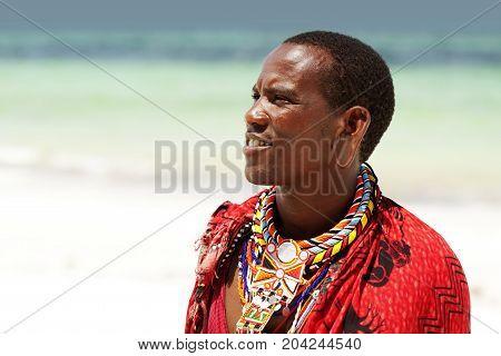 Young Massai Warrior Man Posing On Bright Sunny Beach In Kenya
