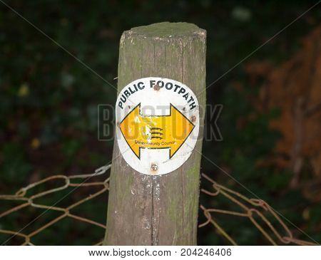 Close Up Of Essex Walking Trail Path Wooden Post With Yellow Arrows