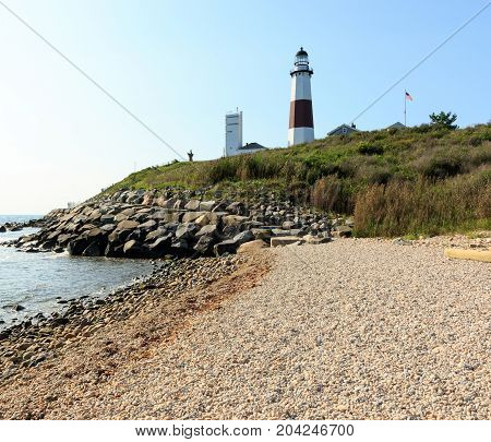 Red and white lighthouse on a bluff overlooking the Atlantic Ocean, Montauk Point, Long Island, New York