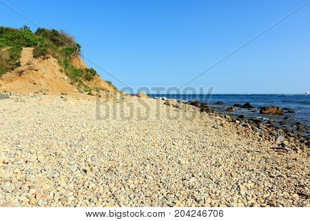 Rocky beach and sand dune at Montauk Point, Long Island, New York