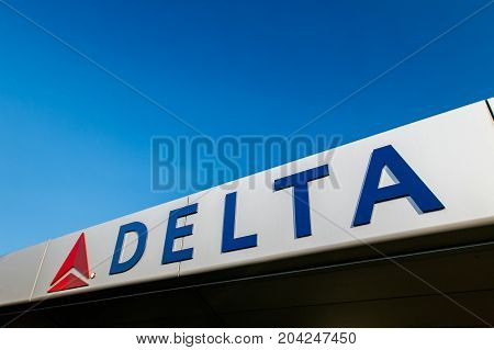 New York August 19 2017: Delta Airlines logo is attached to the front of the awning over the entrance to JFK's Terminal 4.