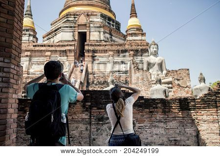 AYUTTHAYA THAILAND - SEP152017 : tourist taking a photograph of wat yai chaimongkol pagoda in ayutthaya province one of world heritage site of unesco in thailand
