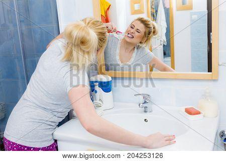 Woman Brushing Cleaning Teeth In Bathroom