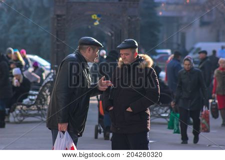 Zhytomyr, Ukraine - September 03, 2015: man want to explain something on street