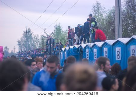 Zhytomyr, Ukraine - MAY 05, 2014: People sitting on toilets outdoor at concert