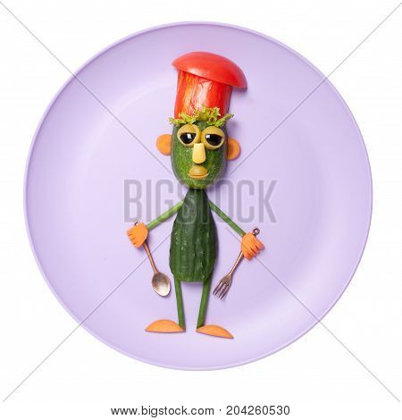 Funny cucumber chief made on purple plate