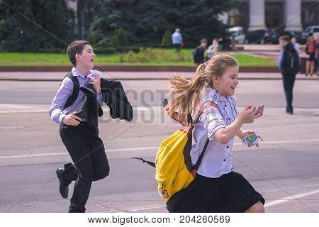 Zhytomyr, Ukraine - September 03, 2015: Young kids return home from school at the street