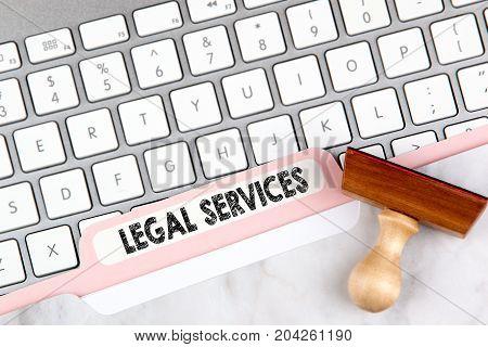 Legal Services Concept. Folder Register on Background of Computer Keyboard.