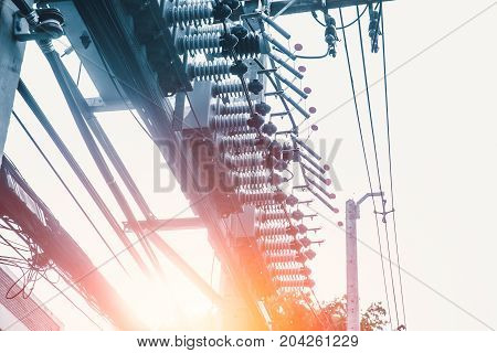 urban electricity high power poles energy supply distribution and transmission high voltage supply concept vintage color tone