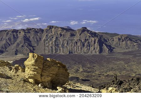 Caldera of the Teide volcano on Tenerife, the Canary Islands, with a big yellow limestone rock