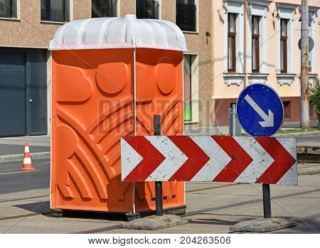 Portable toilet at the road construction in the city