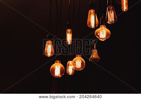 Hanging Dim Vintage Style Tungsten Light Bulb On Dark Background Loft Style Lighting Decoration Conc