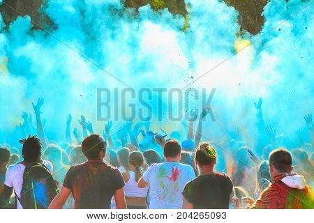 Color festival youth throws up multicolored paint powder