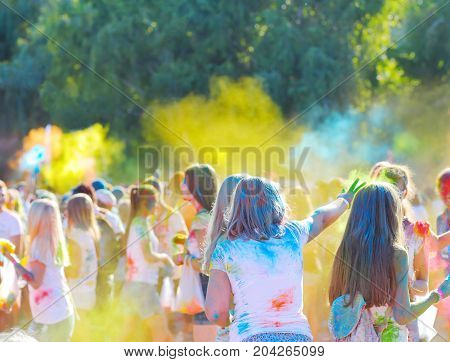 Colors festival youth throw each other multi-colored paints powder