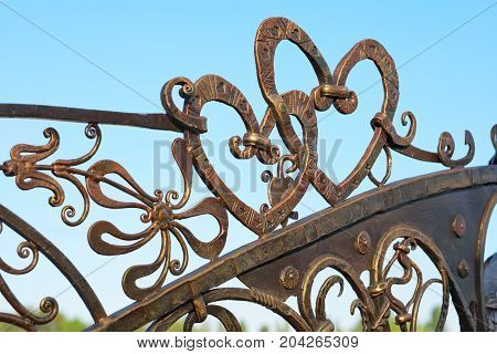 Forged fence wrought iron hearts on the fence