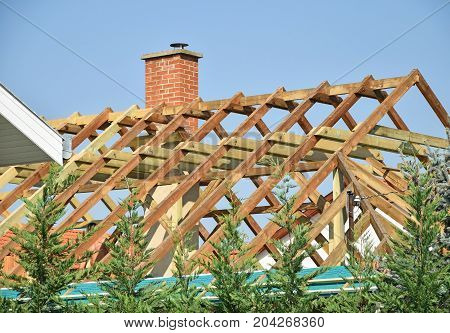 Roof under construction in the city in summer