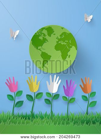 paper art of eco concept with multicolurful hand fower on the grasses and the world .