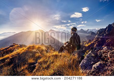 Tourist In The Mountains At Sunrise