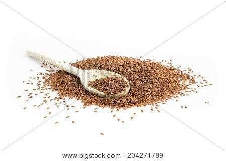 Close up of flax seeds isolated on white background. Shallow depth of field.