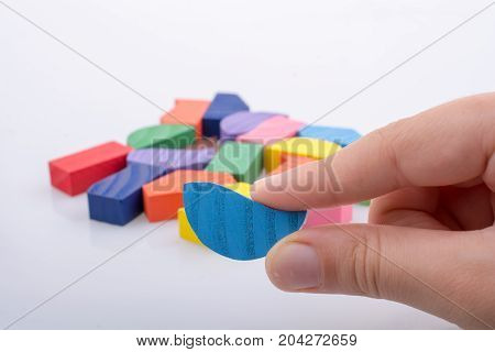 Colorful Pieces Of A Logic Puzzle In Hand