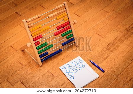 kids learn numbers and counting concept- abacus and numbers in kid notebook