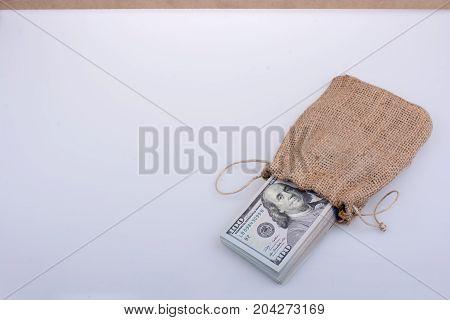 Banknote Bundle Of Us Dollarin A Sack