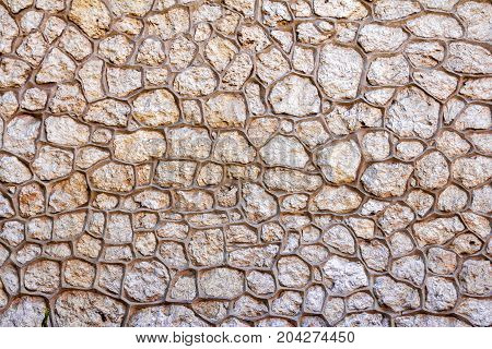 Wall background with stones framed by prominent border, relief surface texture