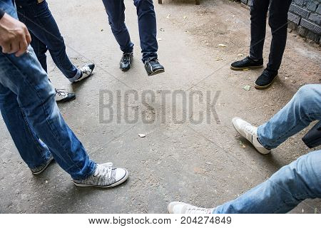 Legs of a group of people standing around