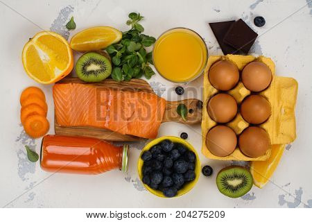 Healthy food good for eyes over white table. Productis fos excellent vision. Space for text
