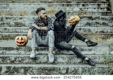 Halloween Couple Sitting On Grey Stairs