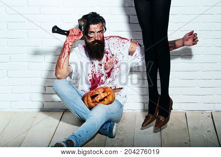Halloween Zombie Bearded Man With Pumpkin, Axe And Female Legs