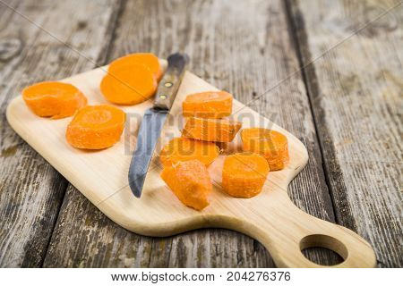 Sliced Carrots And A Knife