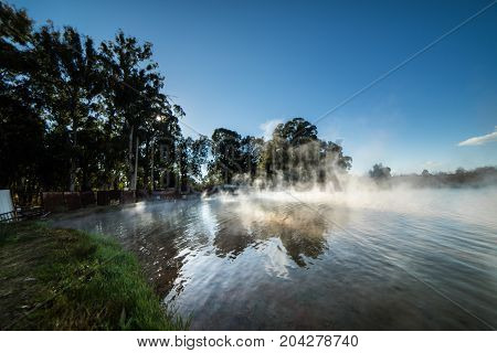 Hot springs in the nature, steam above the water