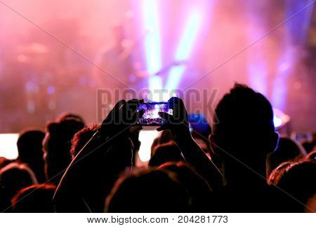 Fans Who Take Photos With Modern Smartphones During The Live Con