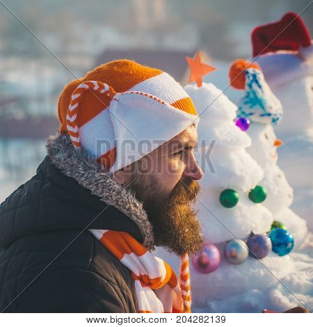 Man In Hat And Scarf On Winter Day