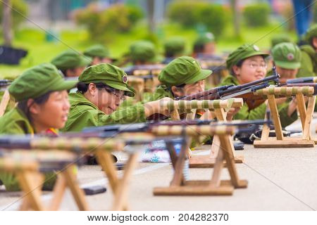 Female Chinese University Military Training Rifle