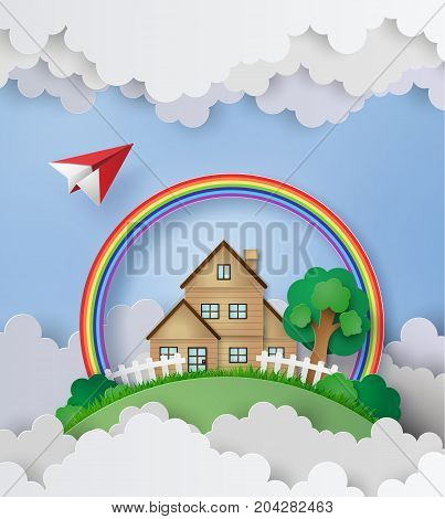 plane fly over the house with rainbow and cloud in the background.paper art and craft style.