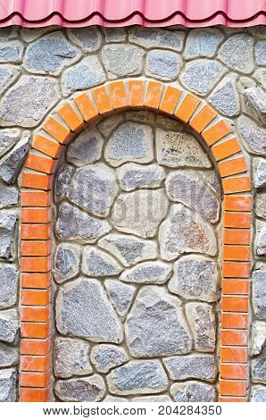 Brick arch in the stone wall roof visor