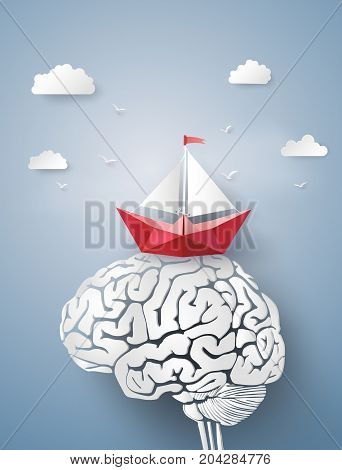 Concept of leader vision and thinking paper boat sailing float on the brainpaper art and craft style