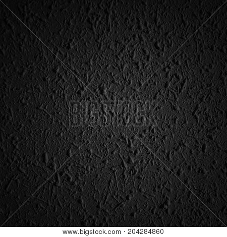 Black asphalt surface. Closeup of dark grunge texture with grain may use as background with copy space