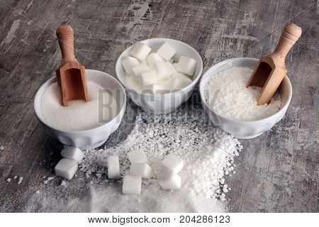 Bowl With White Sand And Lump Sugar On Grey Background